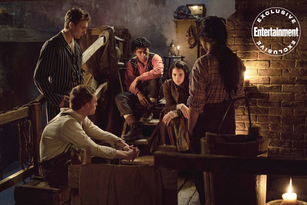The Irregulars sitting together in their hideout. (L to R) Leopold (Harrison Osterfield), Billy (Jojo Macari), Spike (McKell David), Jessie (Darci Shaw) and Bea (Thaddea Graham).