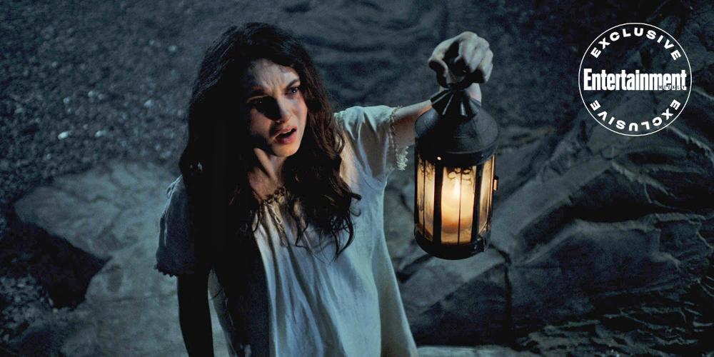 Jessie (Darci Shaw) holding up a lantern in The Irregulars.