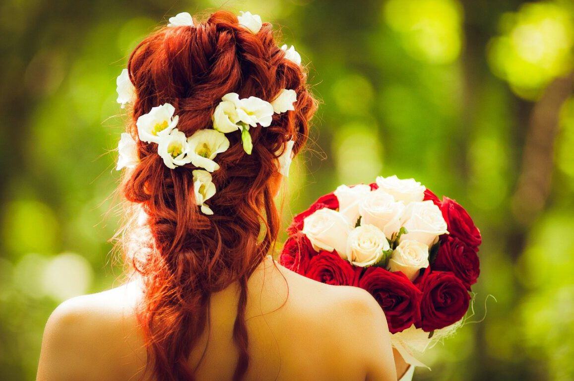 bride holding roses