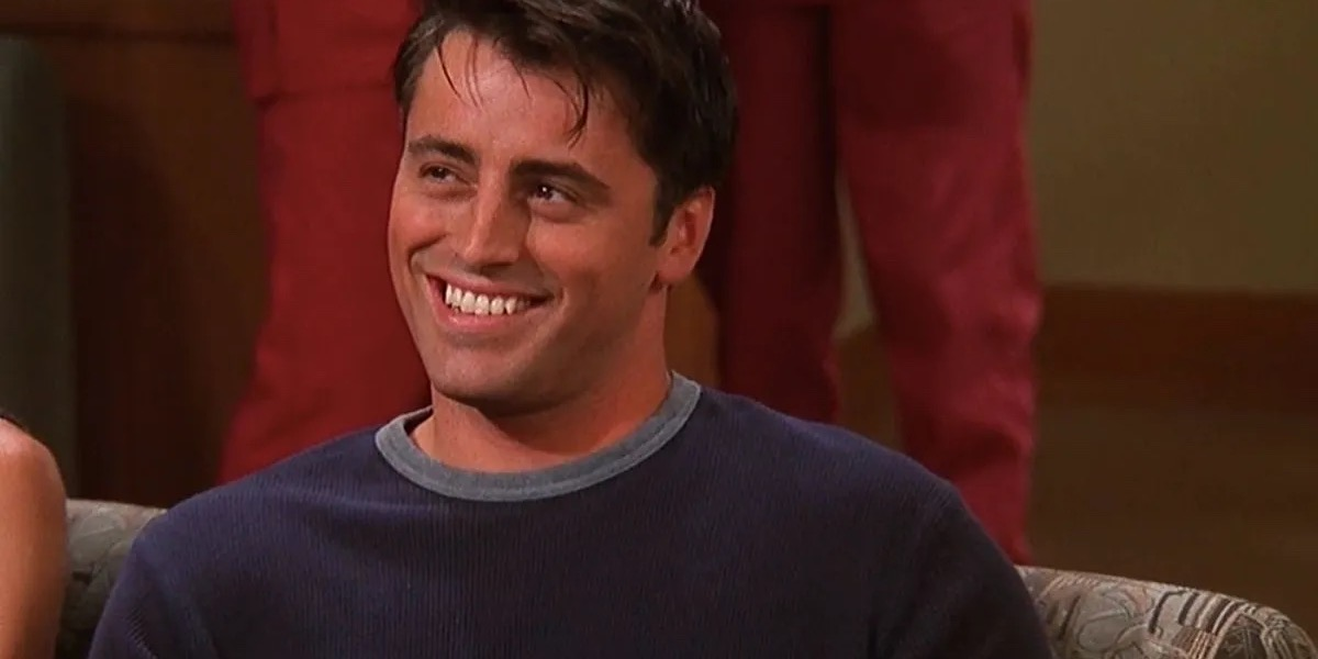 Joey smiles at someone off screen