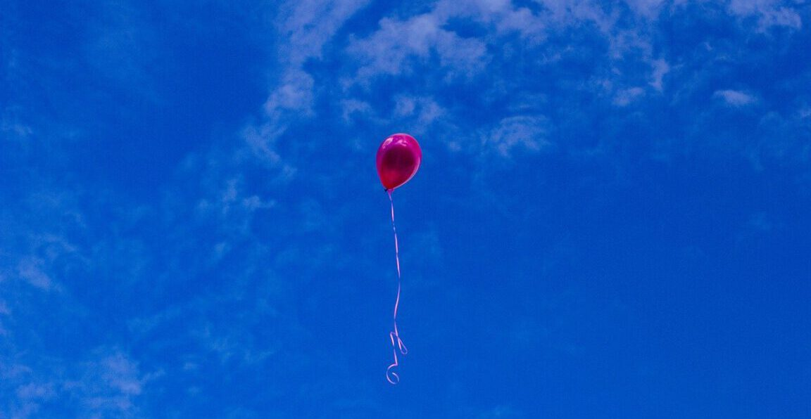 red balloon floating in the sky horror love story