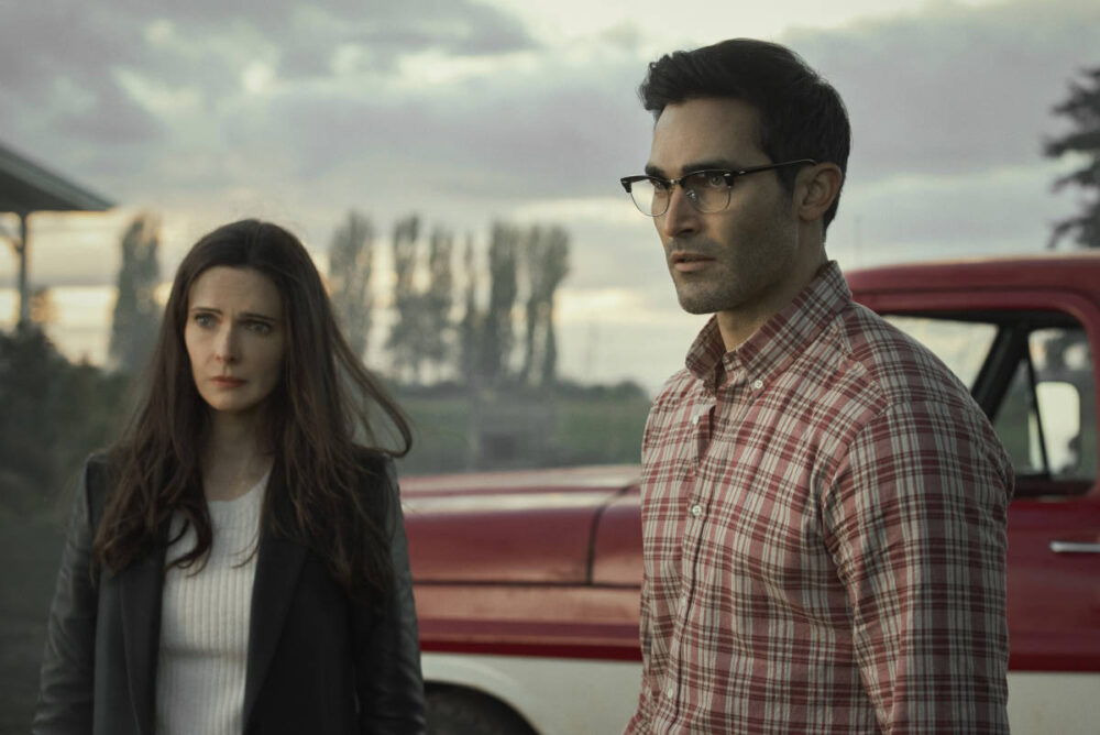 Lois Lane and Clark Kent standing in front of a truck.