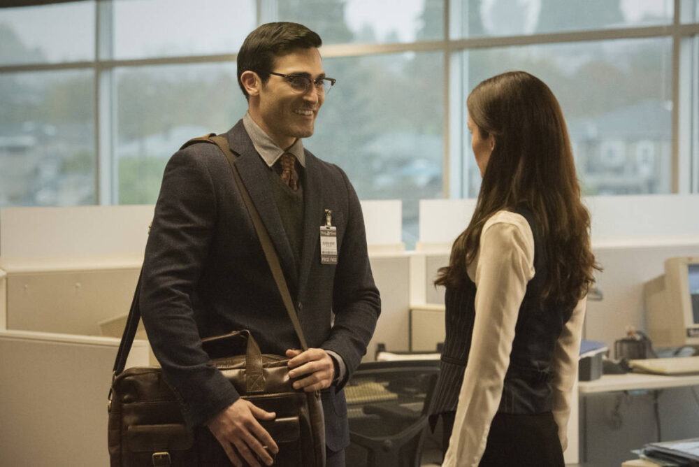 Clark Kent and Lois Lane standing together at the Daily Planet.