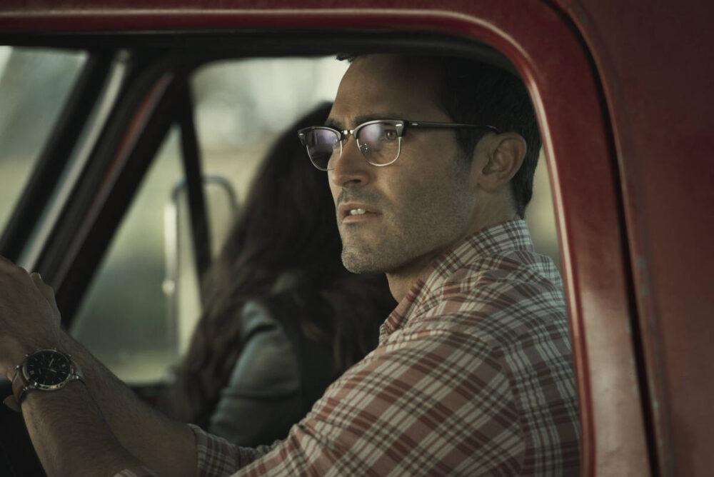 Clark Kent sitting in his truck.