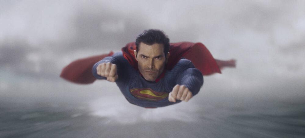 Superman flying through the sky.