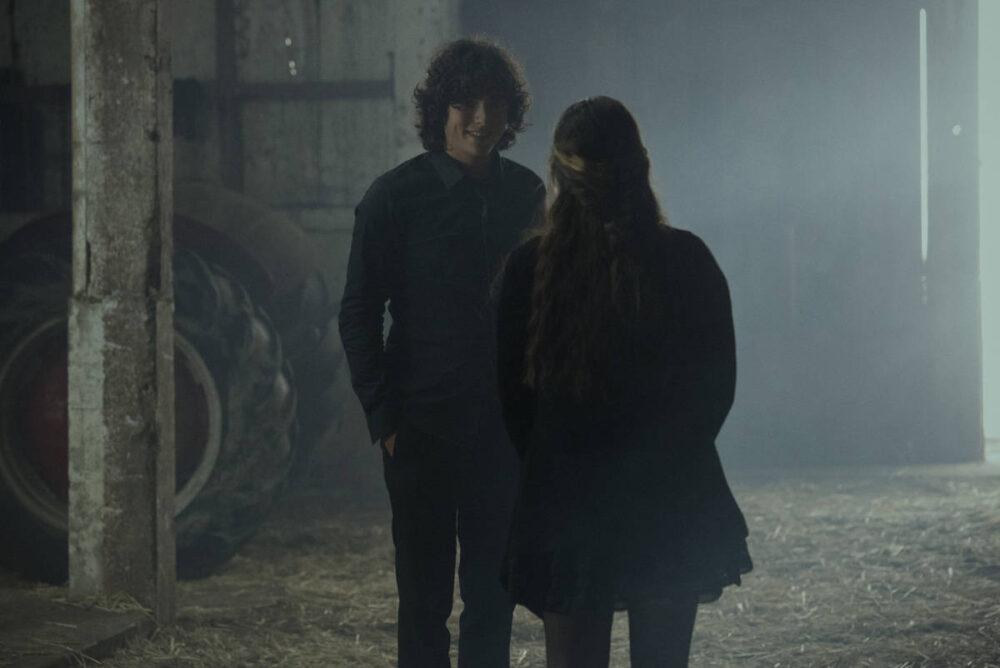 Jordan and Sarah talking in the barn.
