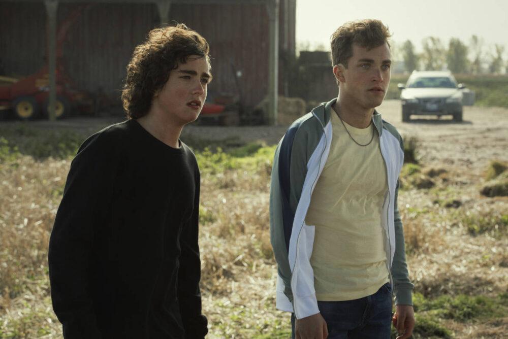 Jordan and Jonathan standing outside the barn.