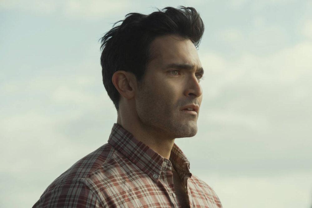 Side shot of Clark Kent standing outside.