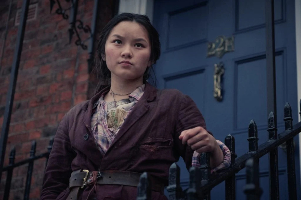Bea outfront of 221B Baker Street in The Irregulars.