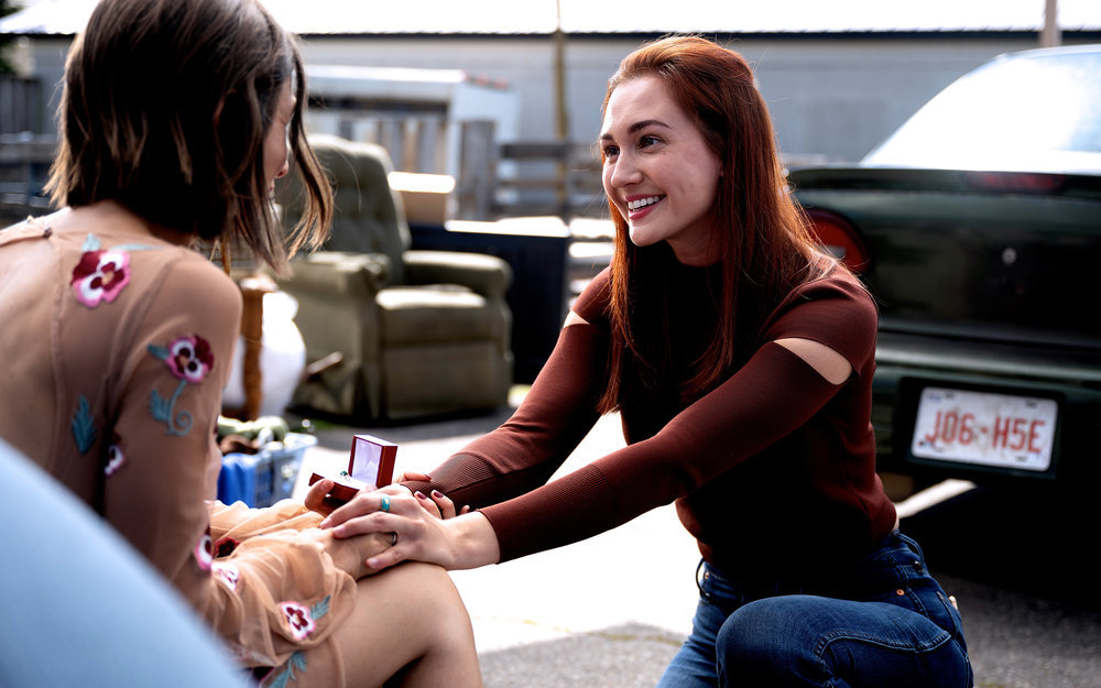 """Still of Dominique Provost-Chalkley and Kat Barrell in Wynonna Earp episode """"Love's All Over."""""""