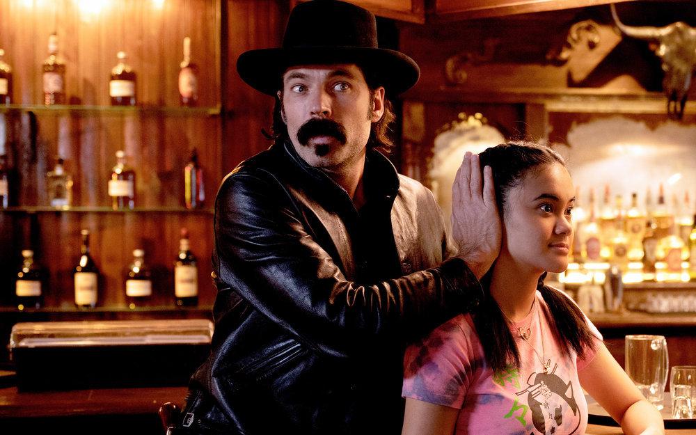 "Still of Tim Rozon and Martina Ortiz-Luis in Wynonna Earp episode ""Crazy."""