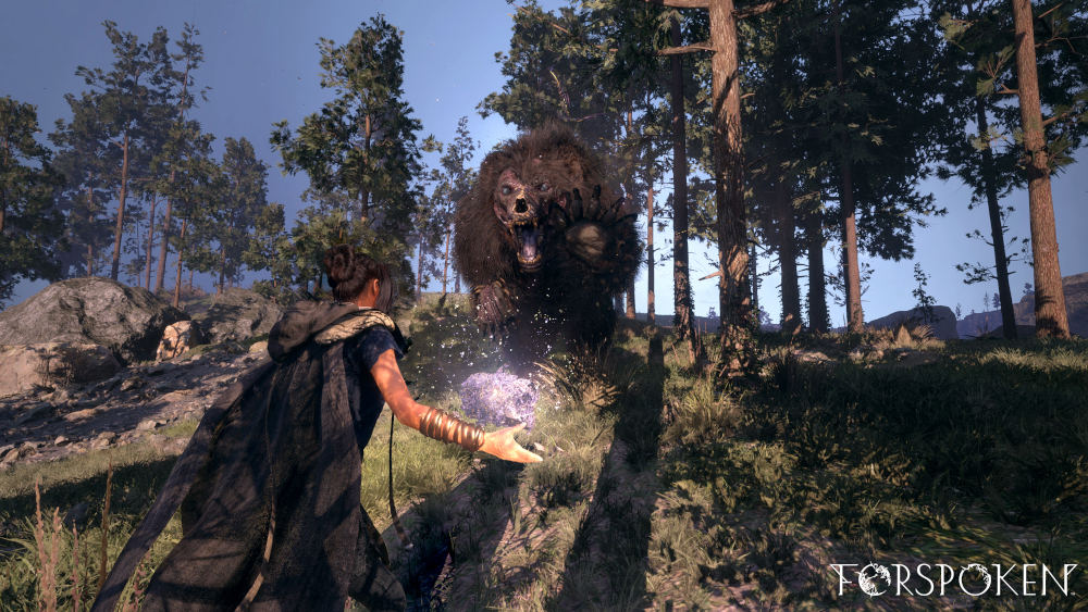 Frey using her powers against a feral bear looking creature in Forspoke.