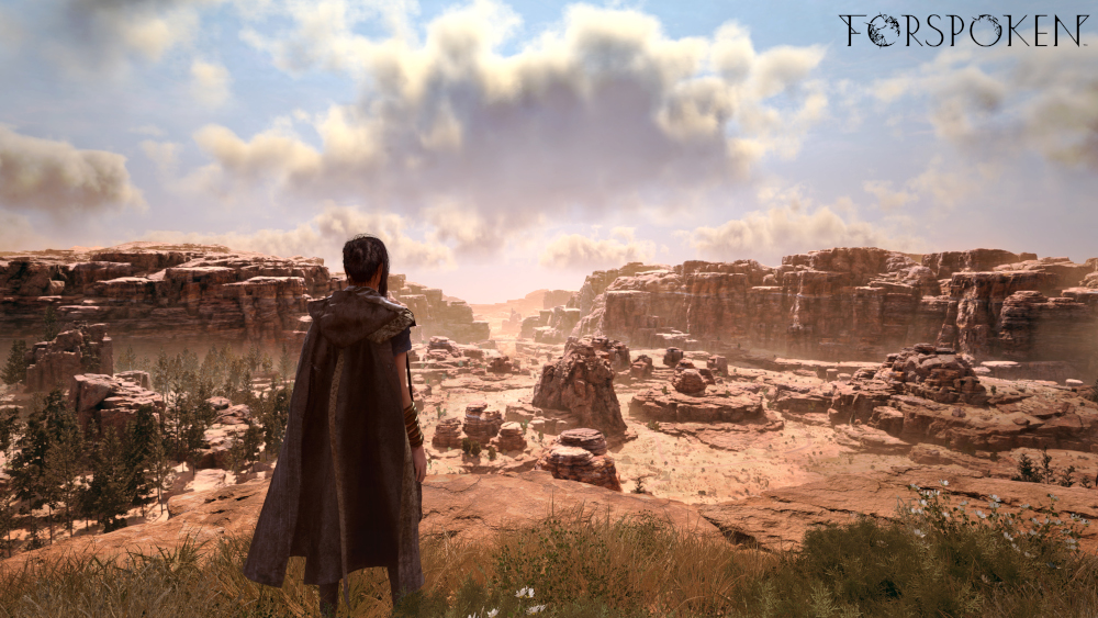 Frey looking out over the mountain landscape of Athia in Forspoken.