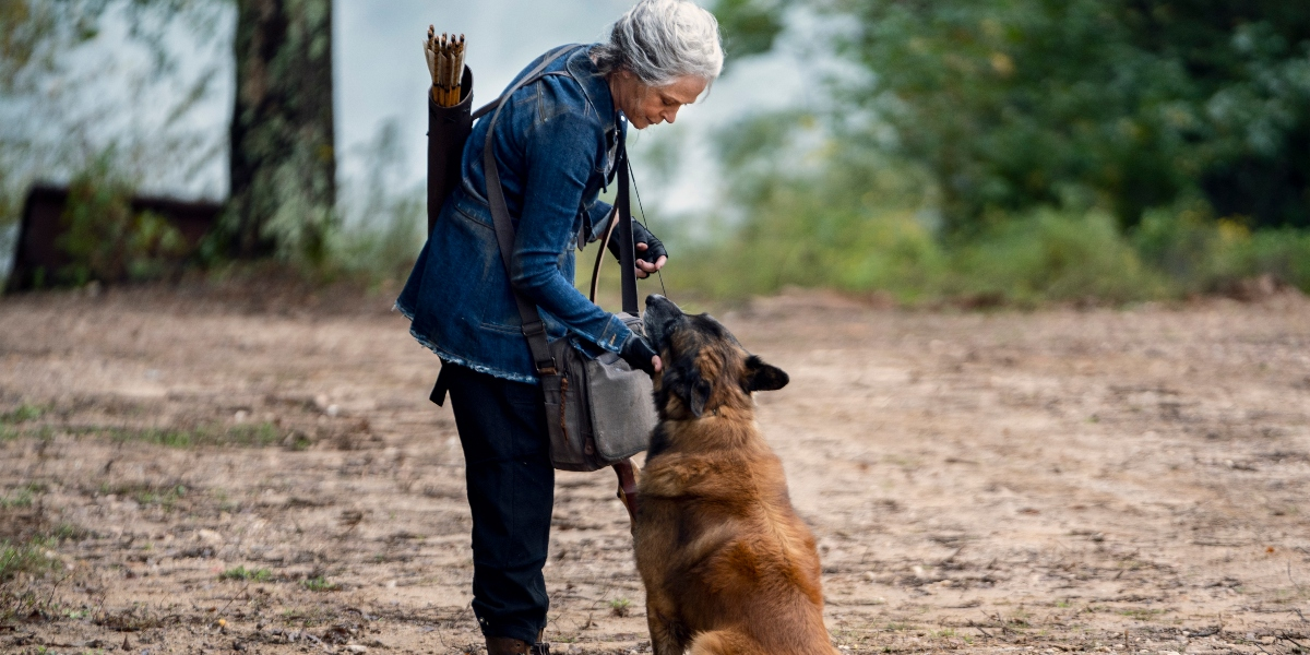 Carol gives Dog some treats on The Walking Dead.