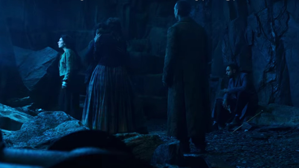 Alice comforting Bea while Jessie inspescts the Rip and Sherlock and Watson look on in The Irregulars.