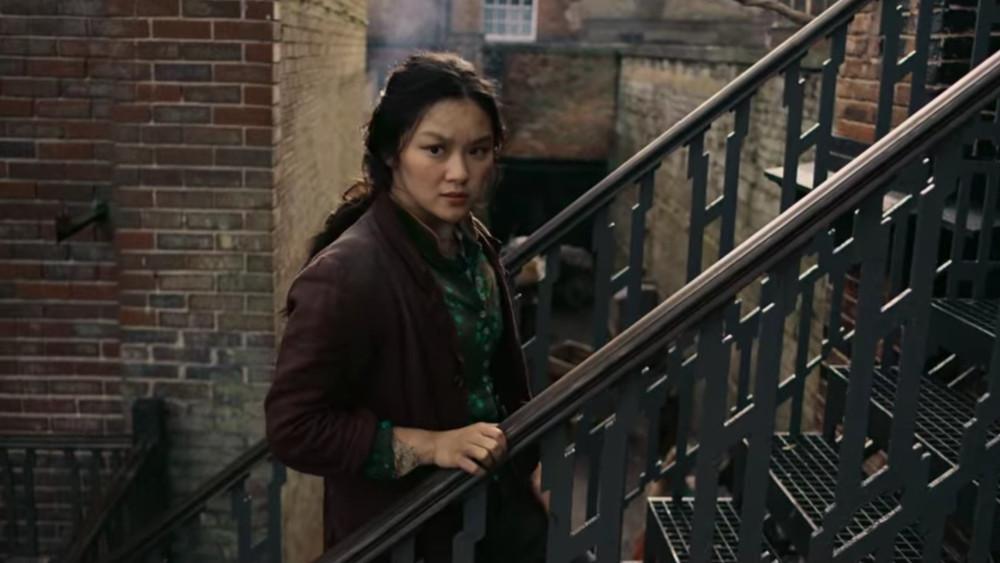 Bea making her way through London in The Irregulars.