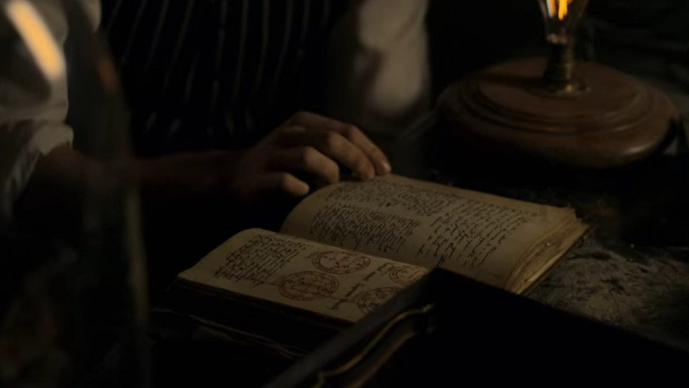 Leopold reading from the grimoire of Sherlock Holmes in The Irregulars.