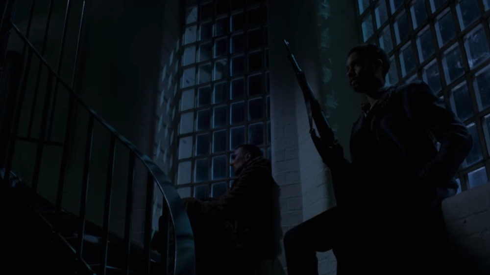 Sherlock and Watson waiting for The Linen Man to arrive in The Irregulars.
