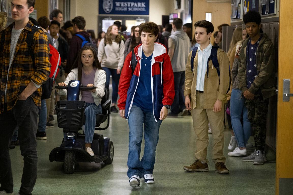 Chad walks in the school hallway