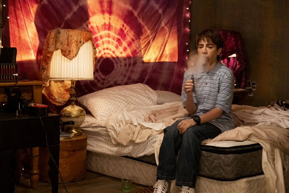 Chad smokes weed on a bed