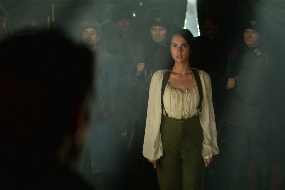 Alina being taken into General Kirigan's tent after the incident.