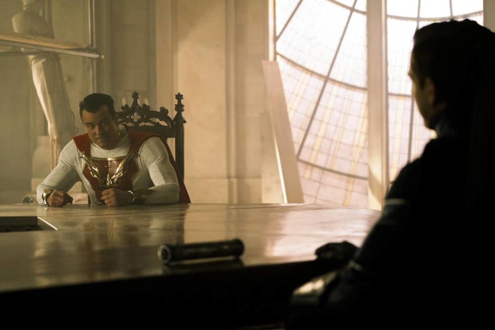 Sheldon and Brandon talking at a table.