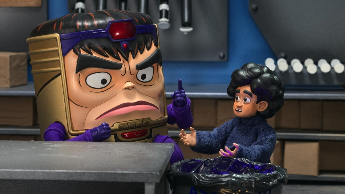Image of M.O.D.O.K., voiced by Patton Oswalt, and Lou Tarleton, voiced by Ben Schwartz.