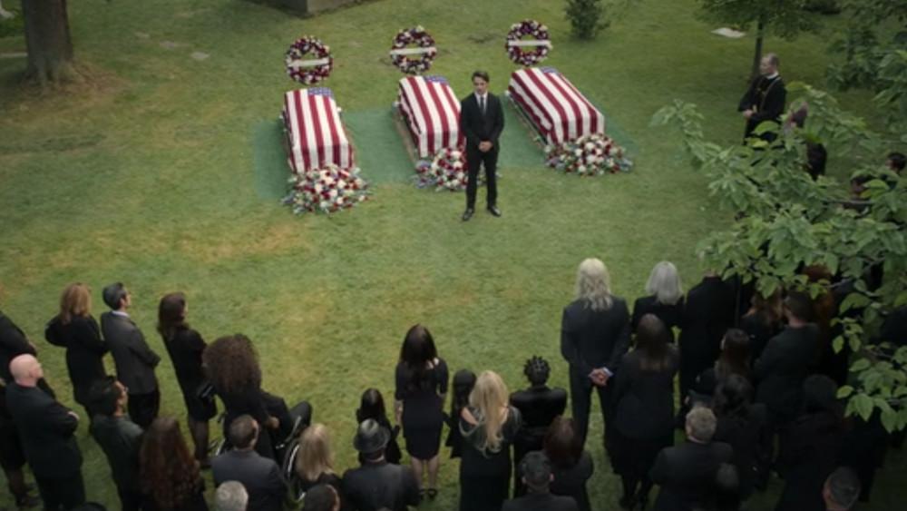 Brandon speaking at the funeral in Jupiter's Legacy.