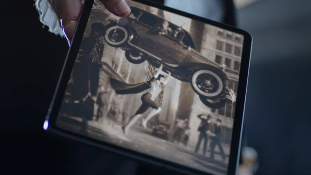 Grace lifting a car abover her head in an image in Jupiter's Legacy.