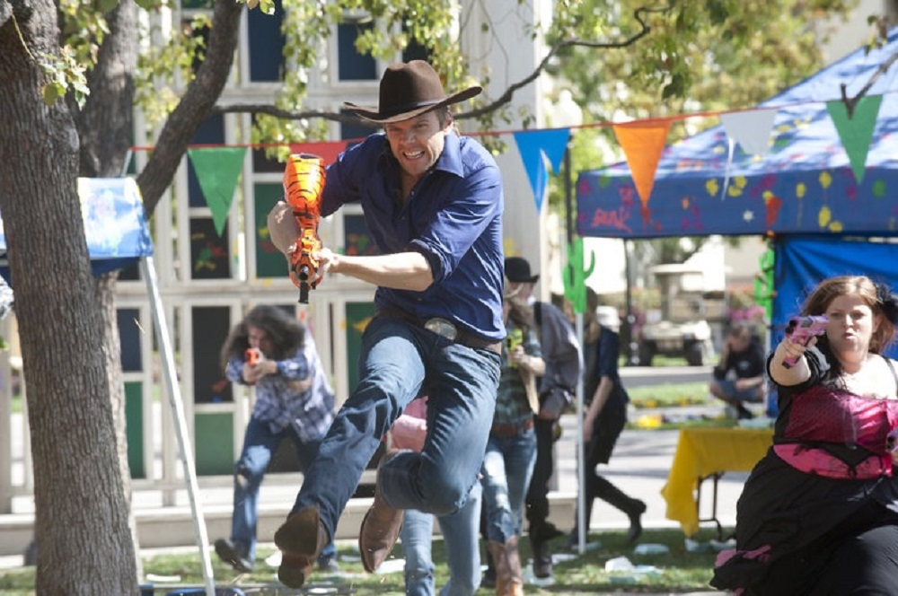 """Still of Joel McHale in Community episode """"For a Few Paintballs More."""""""