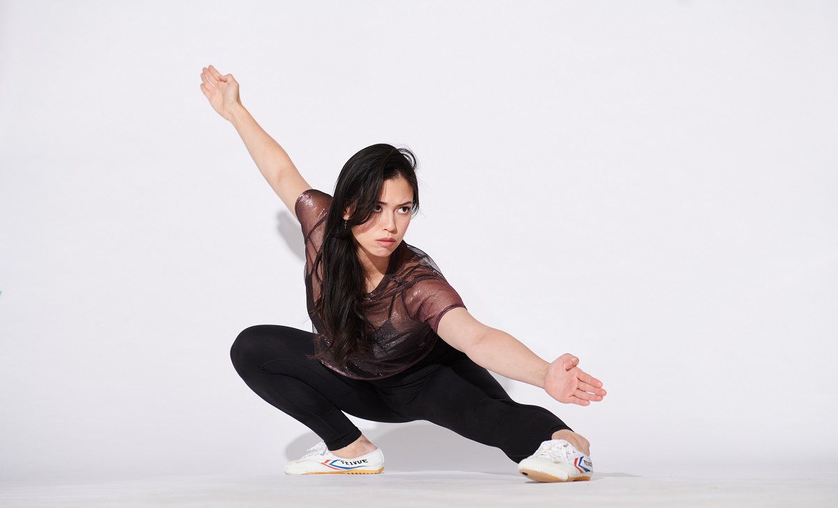 Photo of The Bold Type's Christine Nguyen in an athletic stance. Photo credit: John Bregar.