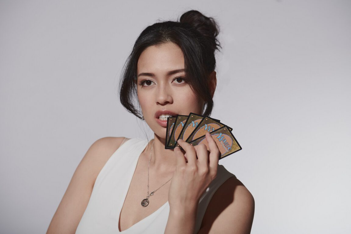 Photo of The Bold Type's Christine Nguyen posing with cards. Photo credit: John Bregar.