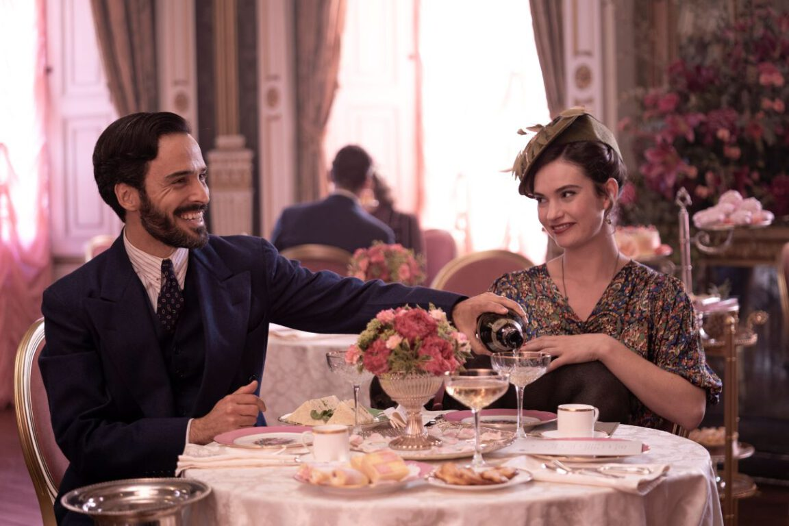 Still of Assaad Bouab and Lily James in The Pursuit of Love.