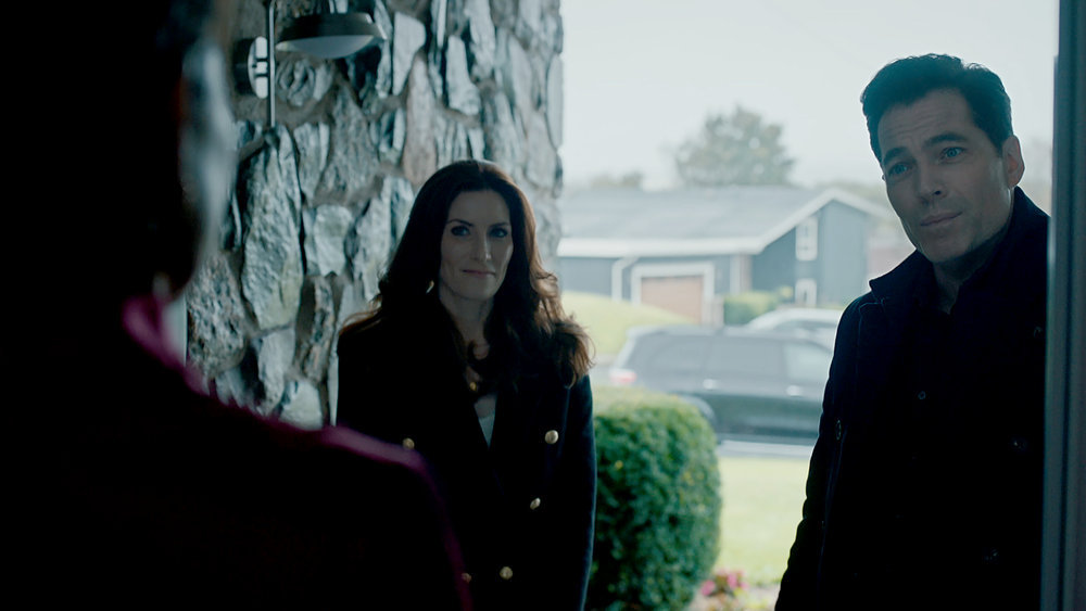 Still of Sarah Levy and Tim Rozon in the SurrealEstate pilot.