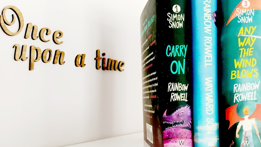 """Carry On, Wayward Son and Any Way the Wind Blows on book shelf with """"Once Upon a Time"""" in background"""