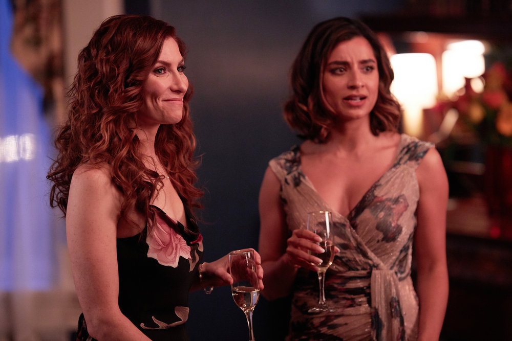 """Still of Sarah Levy and Supinder Wraich in the SurrealEstate episode """"White Wedding."""""""