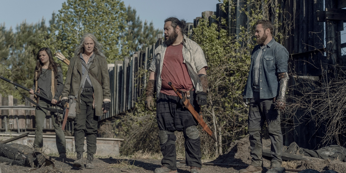 Lydia, Carol, Jerry and Aaron sift through the ashes of Hilltop on The Walking Dead.